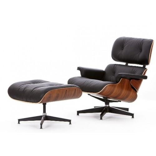 Sillón y apoyapies Charles Eames. Madera de nogal y ecocuero negro. asiento basculante